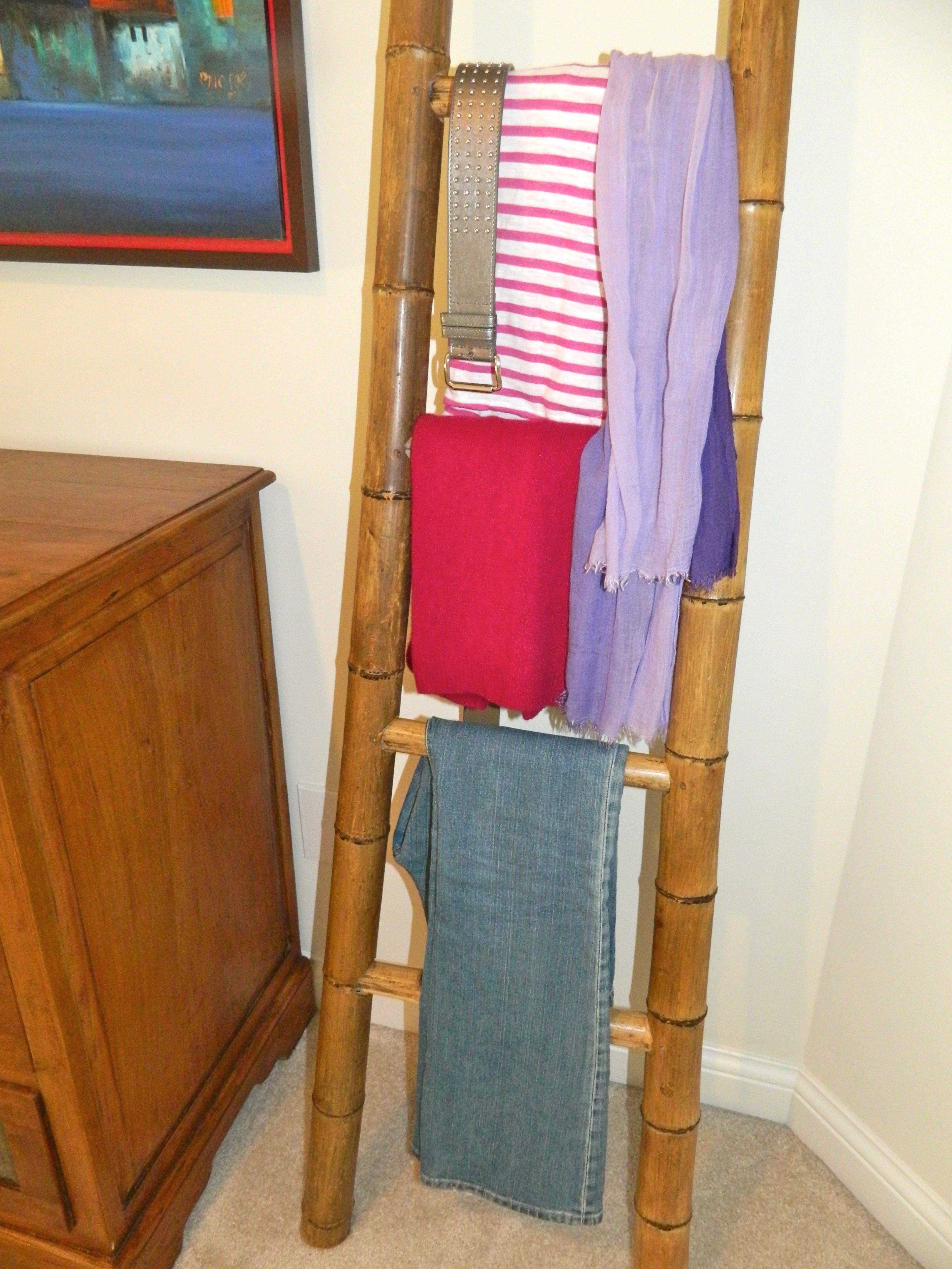 A ladder makes a great place to hang clothes