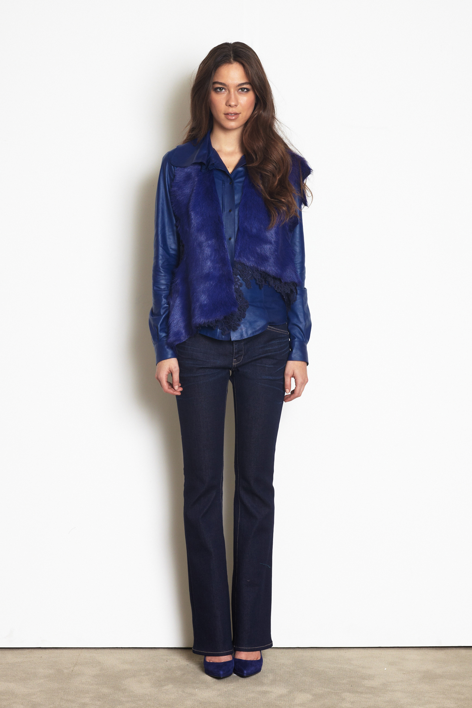 Elie Tahari fur/leather vest, leather blouse and denim pants is a great way to create a monochromatic palette