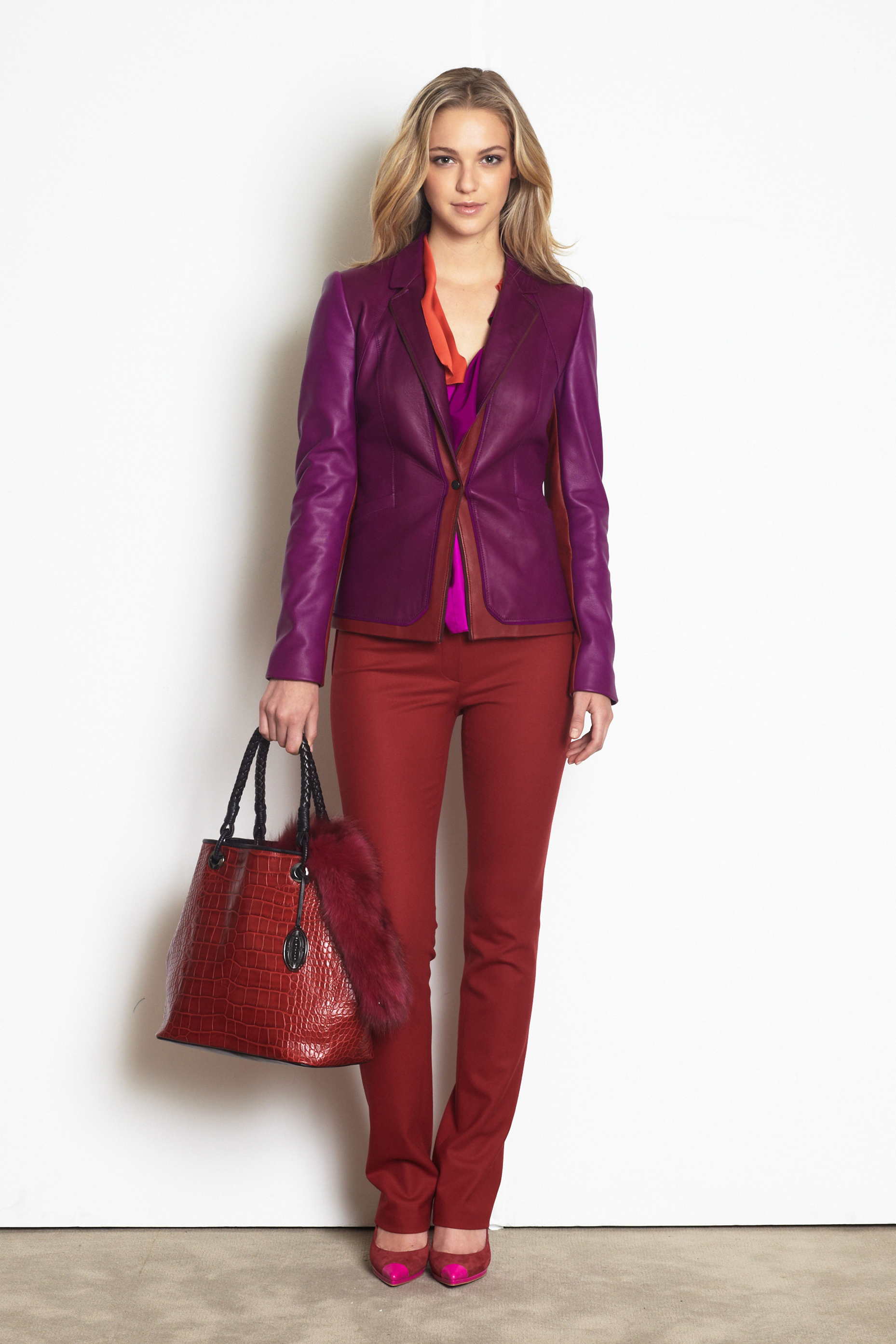 Elie Tahari's leather jacket with bordeaux details, bordeaux wool pants and croc-embossed leather tote