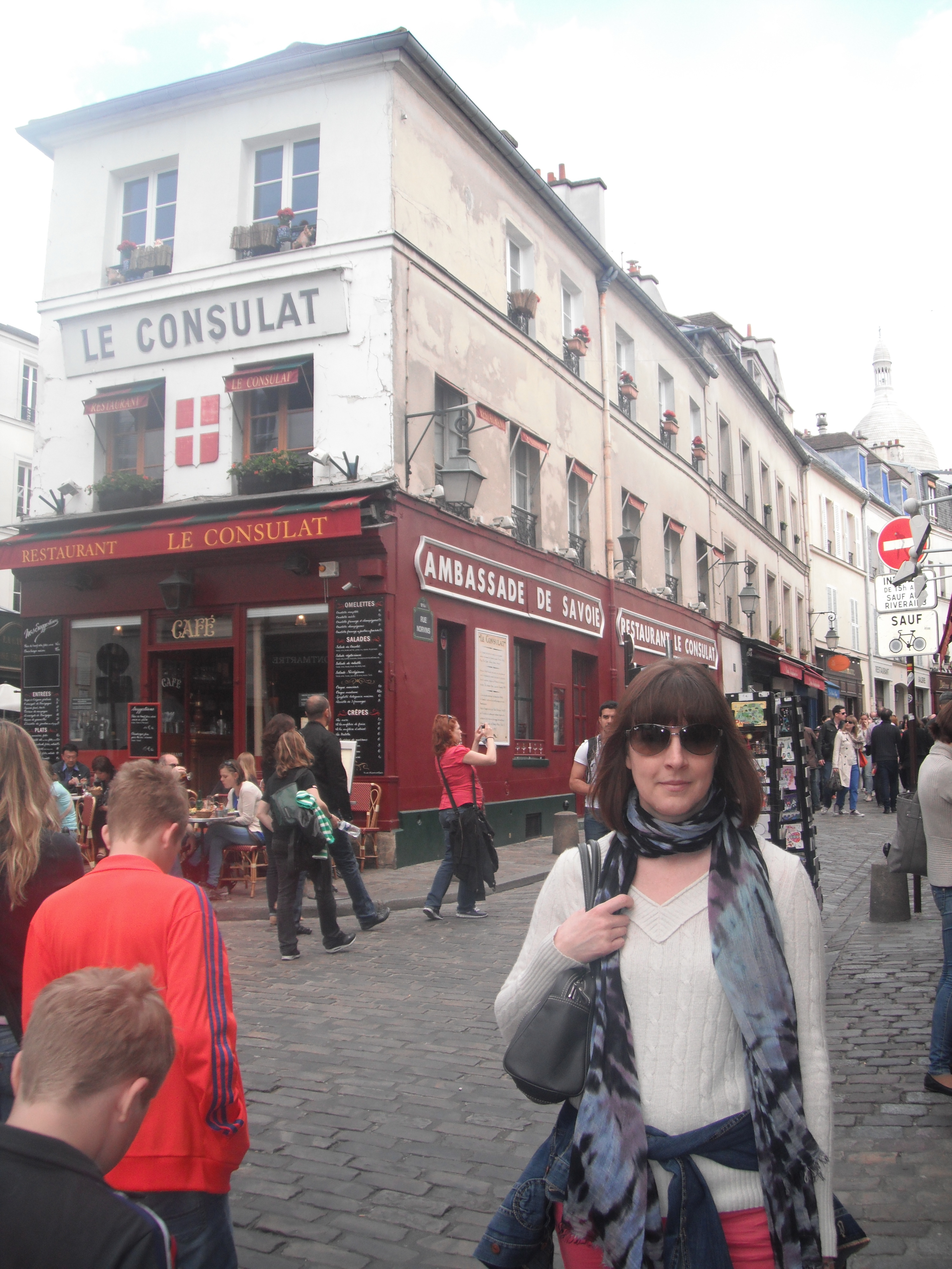 This is me in Montmartre where the Sacre Coeur church is. Notice how I'm clutching my bag. The area is well known for pickpockets!